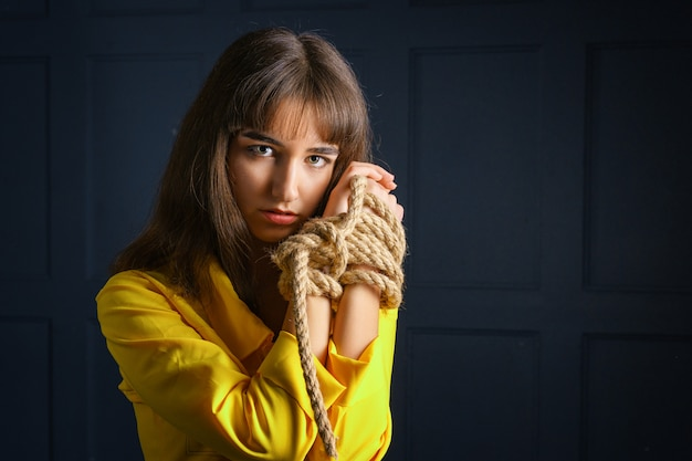 Tied with rope young woman tied hands woman in captivity