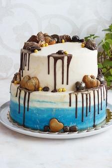 Tiered birthday cake on light