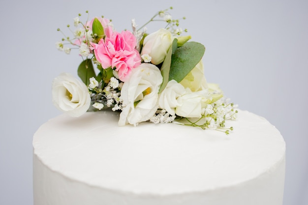 Tiered cake for wedding or birthday. beautiful white and pink festive cake decorated with flowers