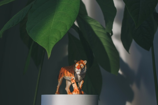 A tiger figurine among the leaves a symbol of the 2022 chinese new year