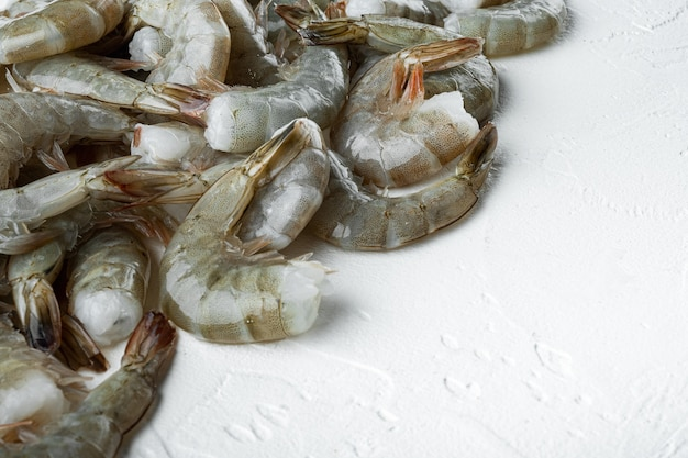 Tiger prawns or asian tiger shrimps set, on white stone  surface, with copy space for text