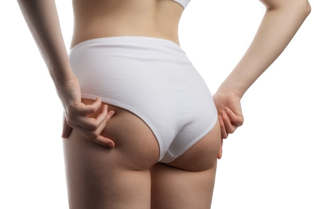 Tight booty girl in white cotton high-rise panties.