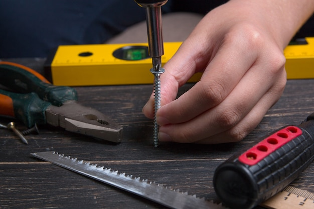 Tightening the screw with a screwdriver