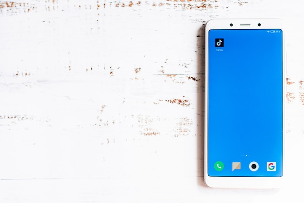 Tik-tok app icon on smartphone screen