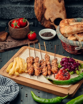 Tikka kebab with french fries and salad