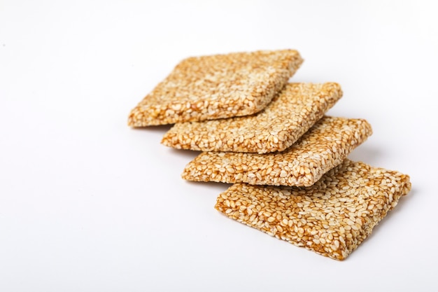 Til chikki and sesame seed ball, indian sweet dish made with jaggery and sesame seeds.