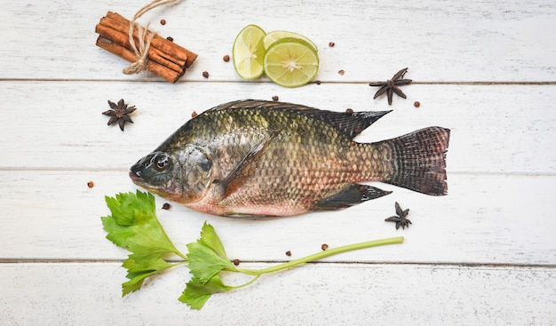 Tilapia fish freshwater lemon lime herb spices vegetable for cooking food in the asian restaurant
