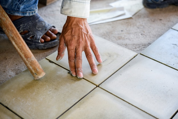 Tile builder by construction worker.