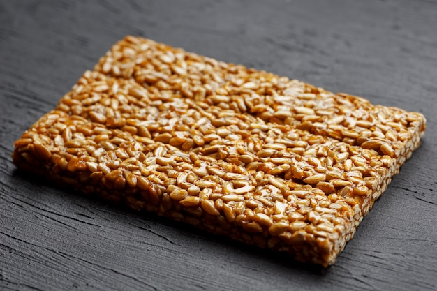 Tile kozinaki from sunflower seeds. delicious oriental sweets gozinaki from sunflower seeds, sesame seeds and peanuts, covered with honey with a shiny icing
