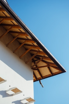 Tile roof of a two-story white cottage