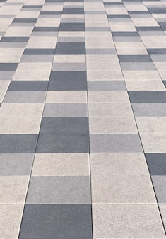 Tiled sidewalk on the street in shades of gray and beige Premium Photo