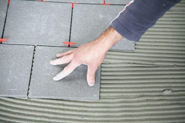 Tiler worker at work