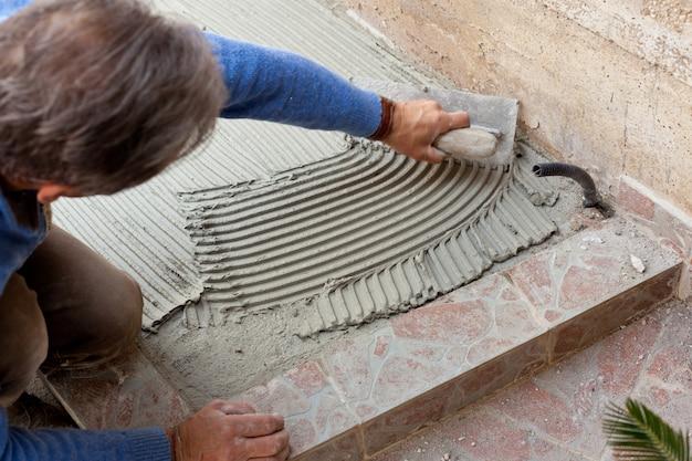 Tiler works with flooring.