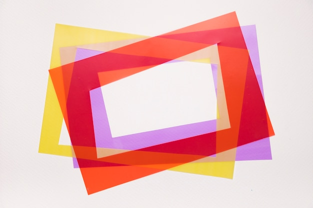 Tilt red; yellow and purple frame on white background