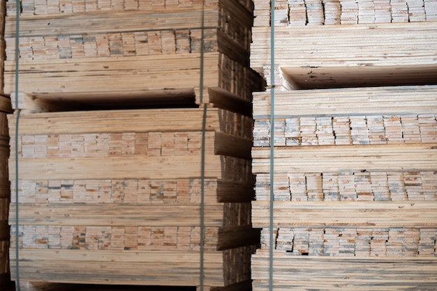 Timber mill, sawmill. storage of planed wooden boards. piles of wooden boards in the sawmill.