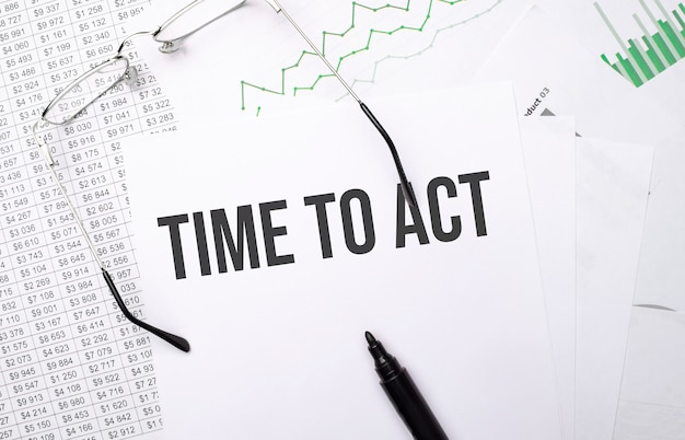 Time to act . conceptual background with chart ,papers, pen and glasses