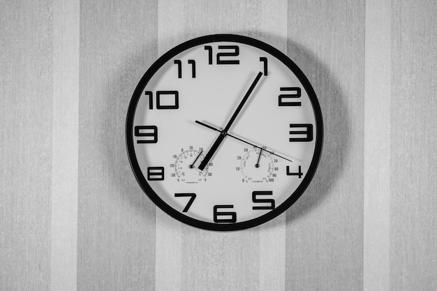 Time concept with watch or clock on white wall