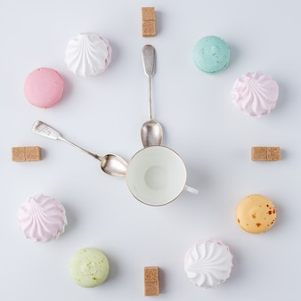Time to drink coffee, a clock in the form of coffee, macarons, sugar, marshmallows,