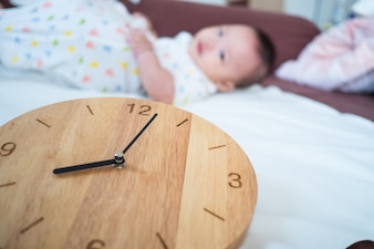 Time for Baby: new born baby and wooden clock