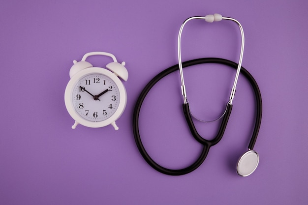 Time is important in life concept. stethoscope kit and alarm clock.