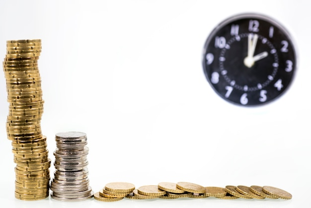 Time is money concept: alarm clock and with coins
