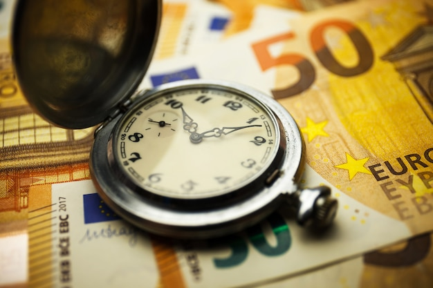 Time is money concept with euros banknotes.