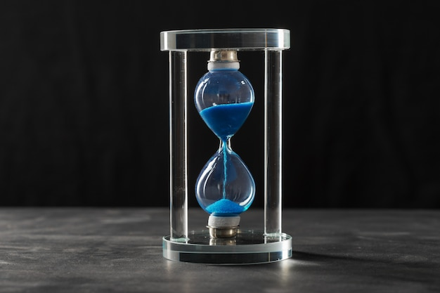 Time is passing. blue hourglass