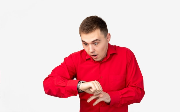 Time is up. appointment deadline. anxious man in red shirt late looking at watch isolated on white background.