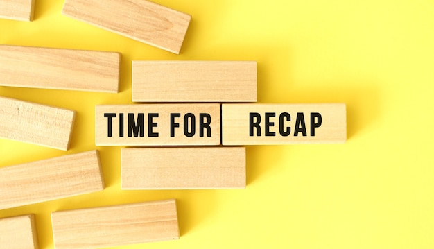 Time for recap text written on a wooden blocks on a yellow background
