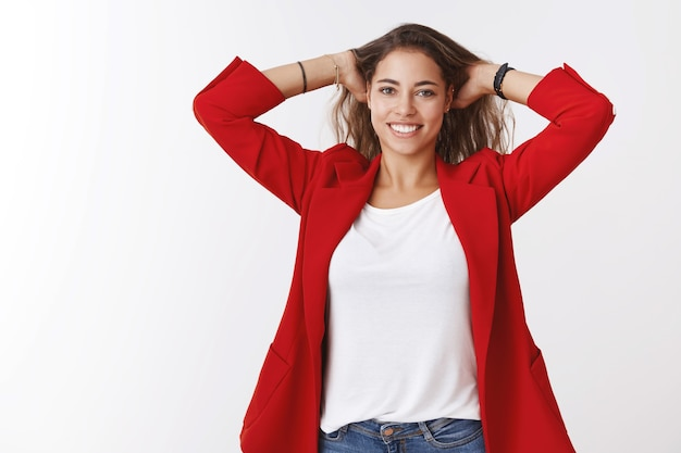 Time rest. portrait of relaxed relieved happy young good-looking female entrepreneur finished work massaging head playing hair smiling broadly joyful, joyful weekend finally came, white wall