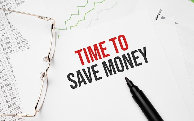Time to save money writing with chart, papers, pen and glasses