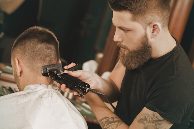 Time for some grooming. horizontal shot of a professional barber giving a haircut to his client