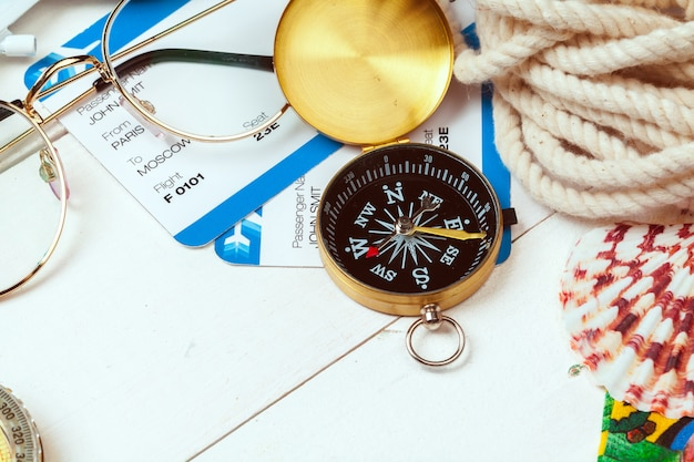 Time to travel. idea for tourism with tickets and compass.