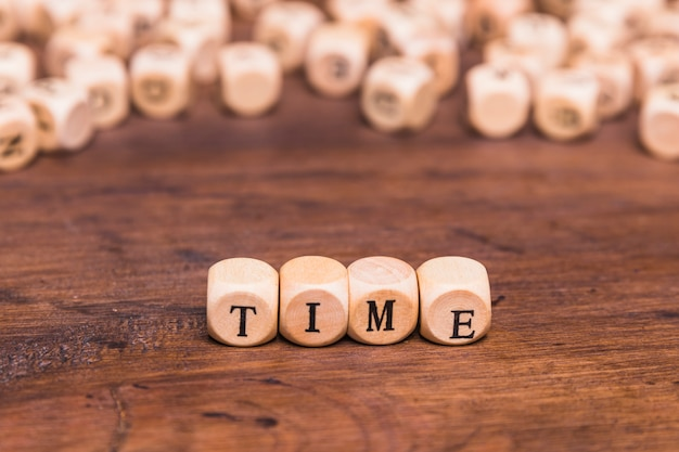 Time word made from wooden cubes