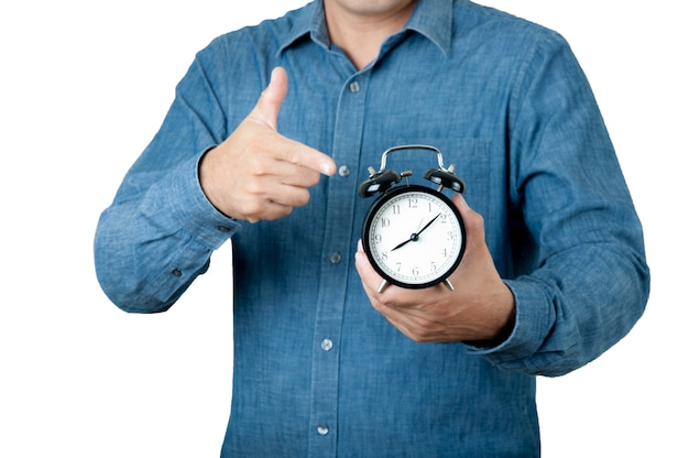 Times concept. man hold alarm clock in his hand on isolate background.