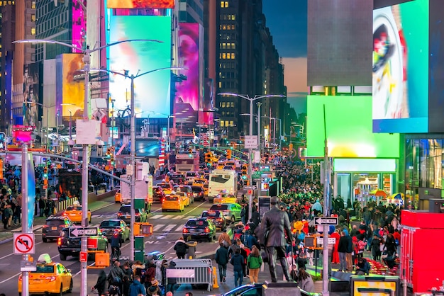 Times square area with neon art and commerce, an iconic street of manhattan in new york city , united states