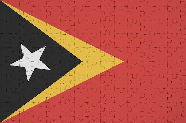 Timor leste flag  is depicted on a folded puzzle