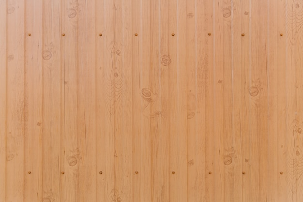 Tin fence with a beautiful textured pattern, modern fence with vertical stripes