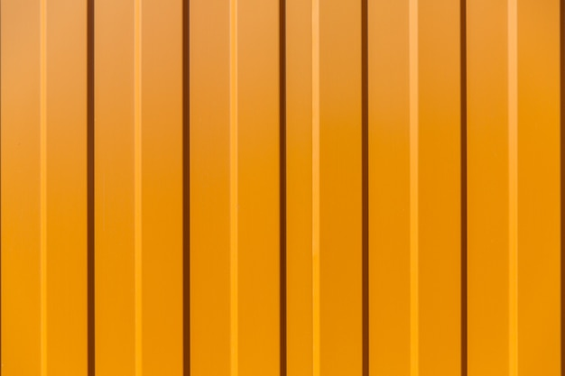 Tin fence with a beautiful textured pattern, modern fence with vertical stripes.