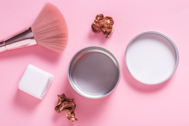 Tin metal cosmetic box, case on pink background