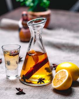 Tincture with anise cinnamon drink lemon peel side view
