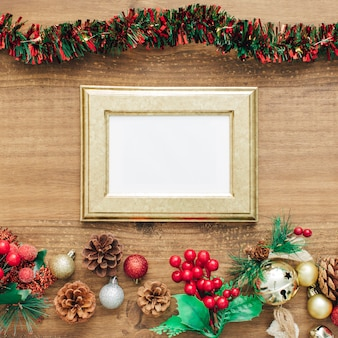 Tinsel and decorations for christmas with golden frame