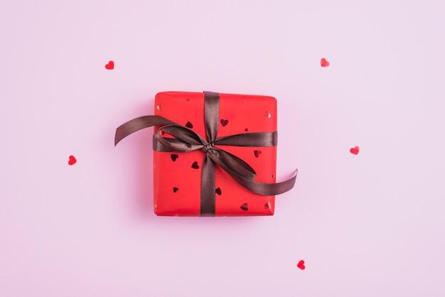Tiny hearts around valentine's day present