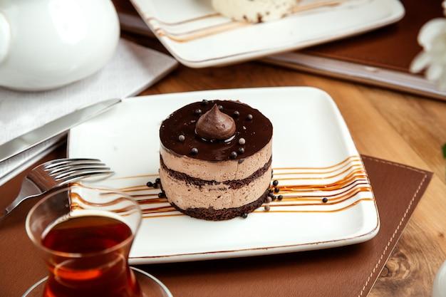 Tiramisu cheese mascarpone and chocolate pearls on plate