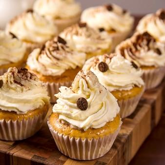 Tiramisu cupcakes decorated with cocoa powder and coffee grains