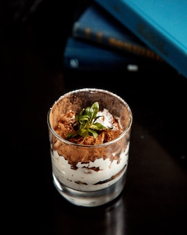 Tiramisu dessert topped with greenery