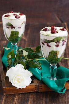 Tiramisu in a glass of tea match and cherry