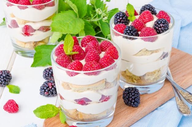 Tiramisu in a glass with coffee sponge cake and fresh berries