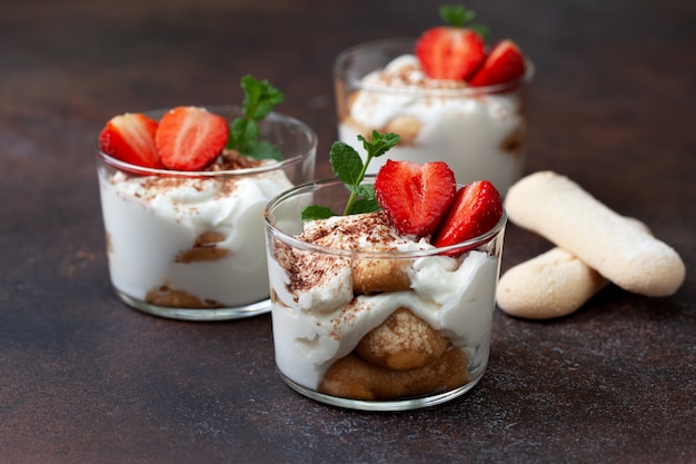 Tiramisu in a glass with fresh strawberries