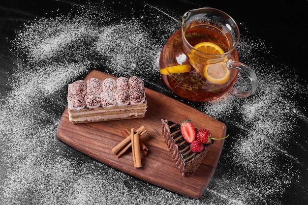 Tiramisu slice with wine on a wooden platter .